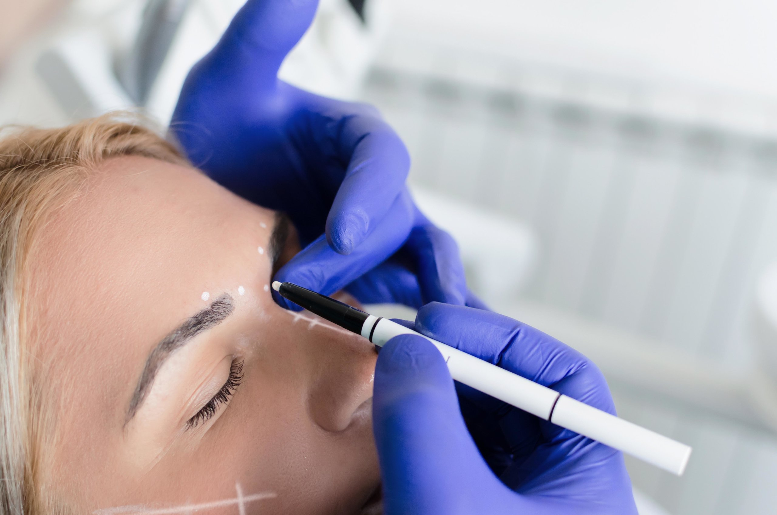 Close up of doctor doing preparations for botox procedure on female patient. Space for text.